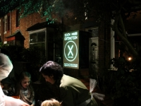 SIXTH MASS EXTINCTION: snack bar on the street with Halloween revellers